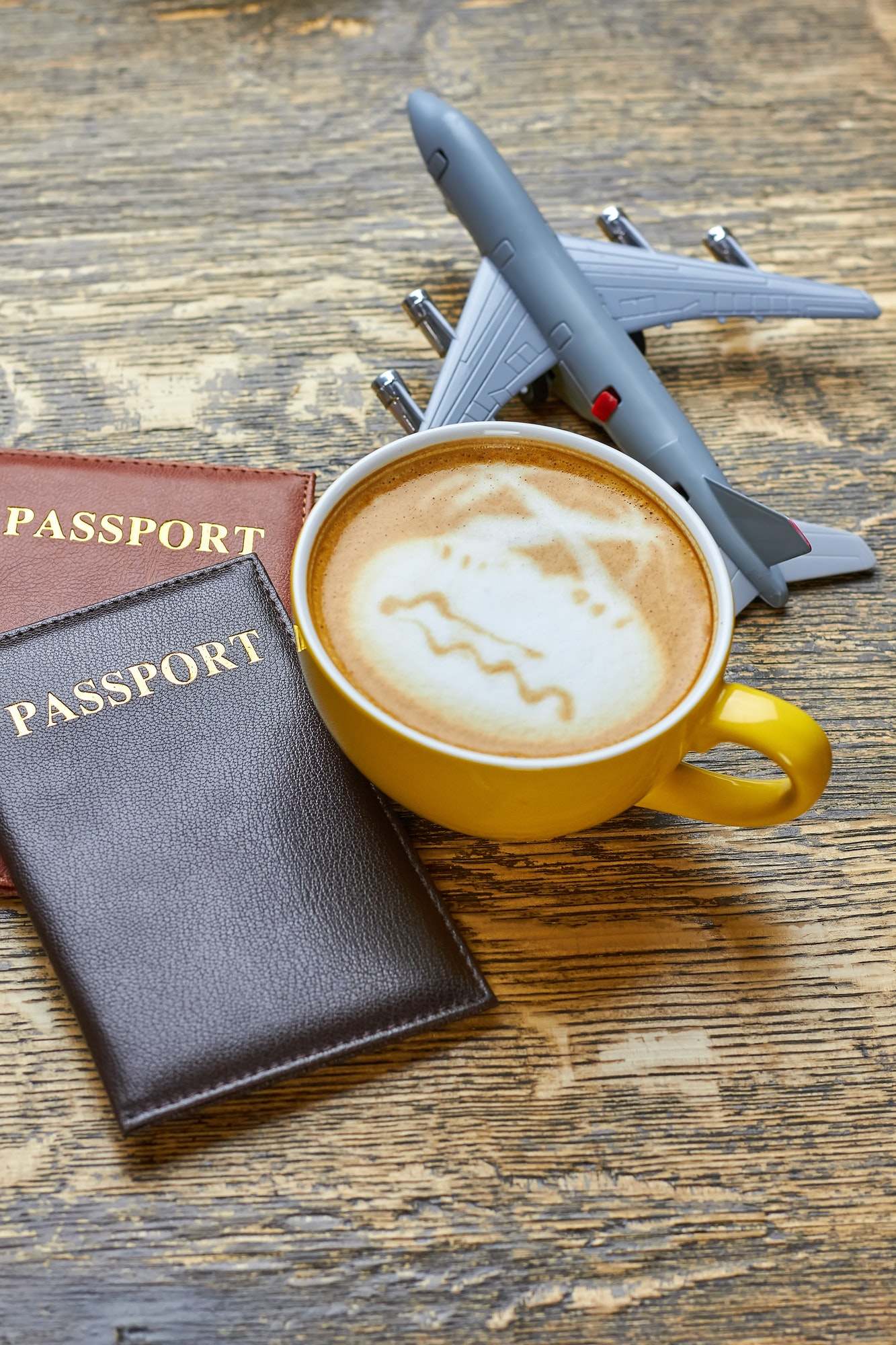 Coffee, passports and toy plane